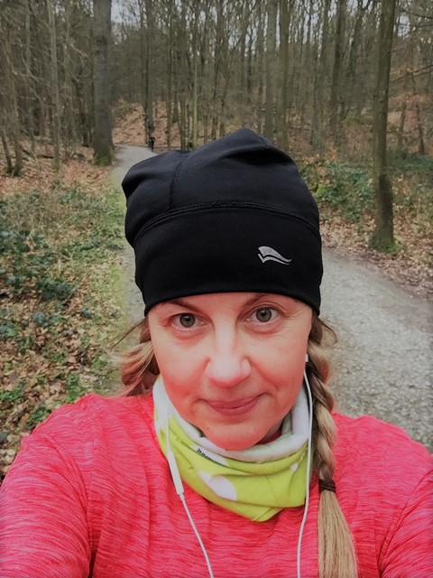 Run in the forest wearing black hat