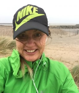 Windy rainy run on the beach
